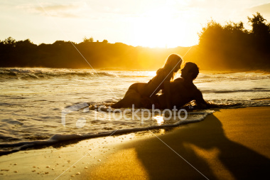 ist2_5602715_young_couple_at_sunset.jpg