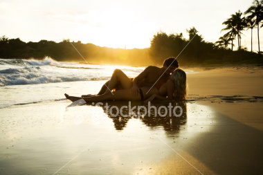 ist2_5551555_young_couple_at_sunset.jpg